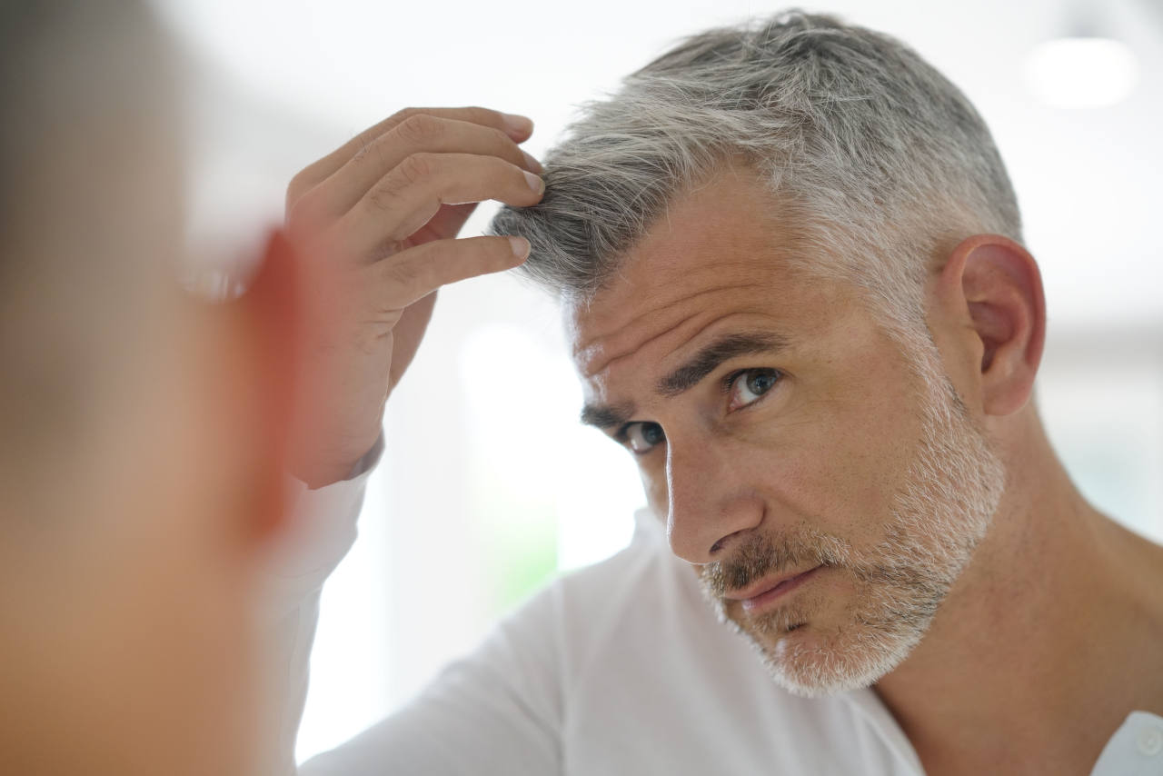 a man with the first signs of greying hair