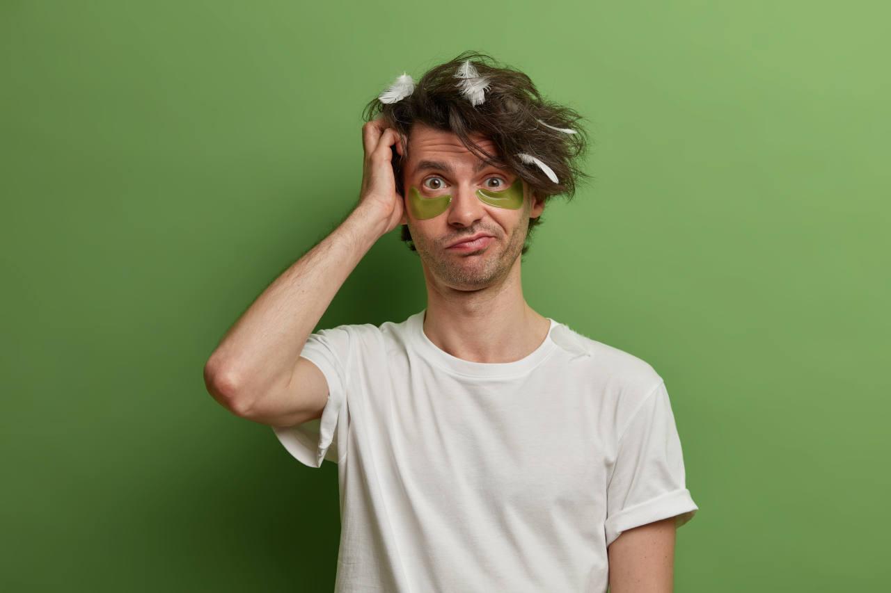 a man applying a hair treatment at home