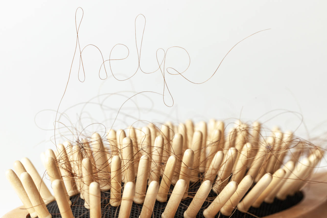 a hair strand that has fallen out as a signal of poor hair health