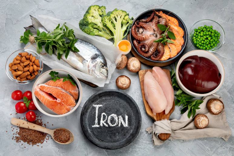 Food high in iron on light grey background