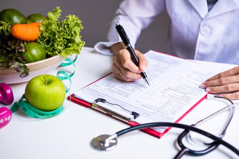 a nutritionist creating an iron rich diet plan against anaemia