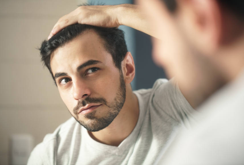 man worried about his receding hairline
