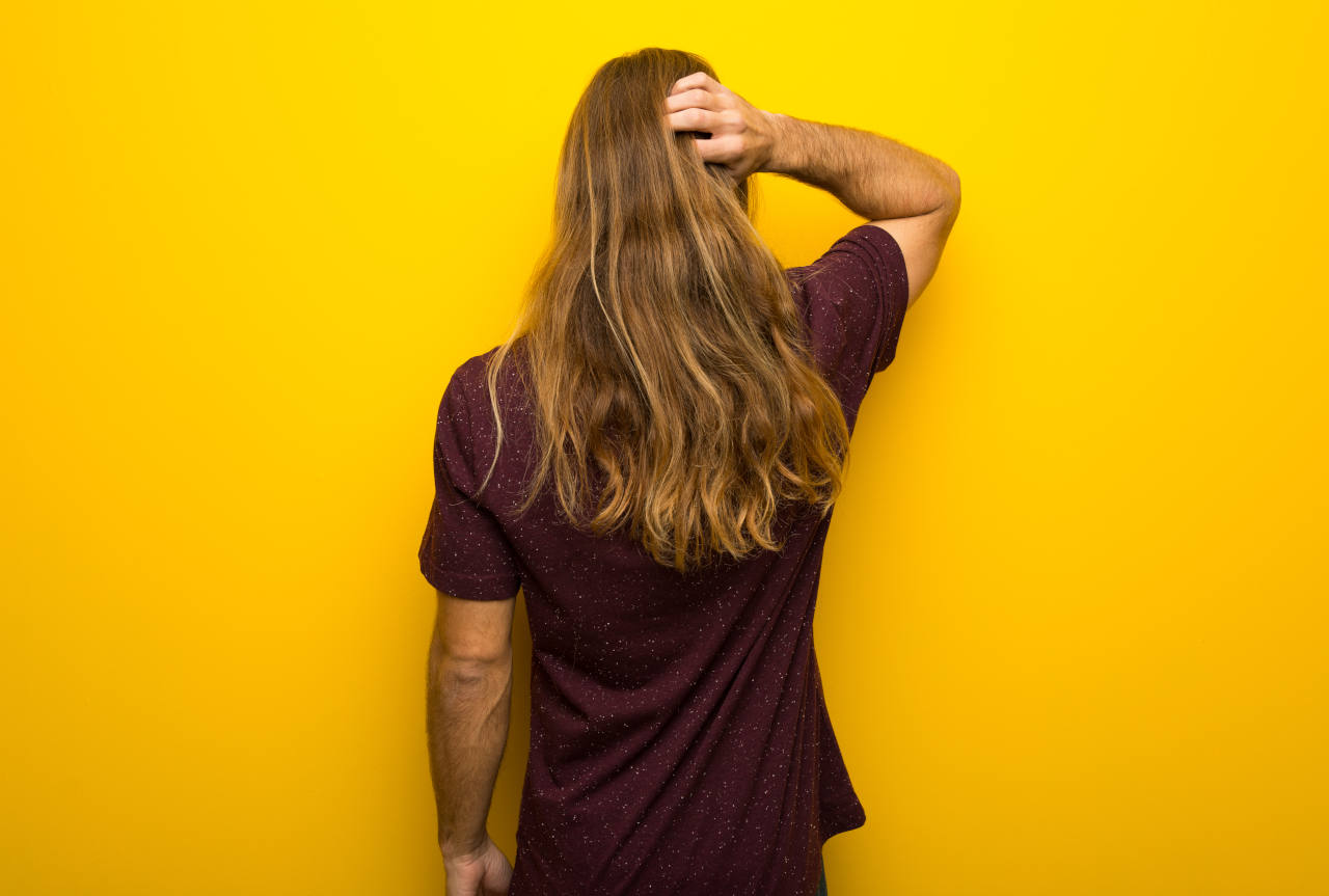 A close up of a man with very long hair