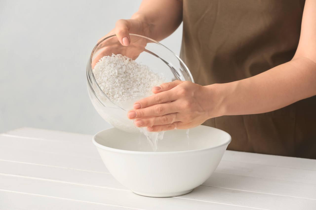 A woman preparing rice water for hair