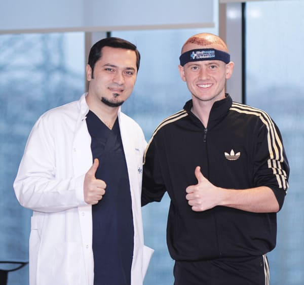 Dr Balwi with a patient who had a positive experience with Elithair