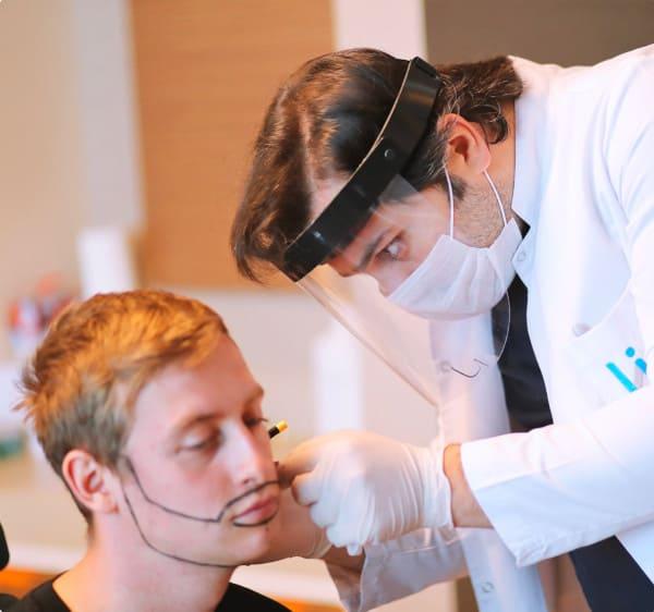 Dr Balwi during a beard transplant
