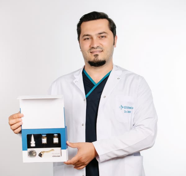 Dr Balwi holding a NEO FUE Kit in his hand