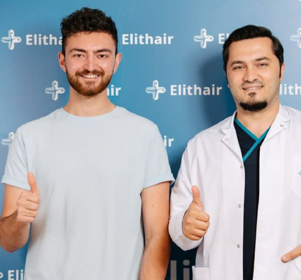 Dr Balwi and a patient at the Elithair clinic in Turkey