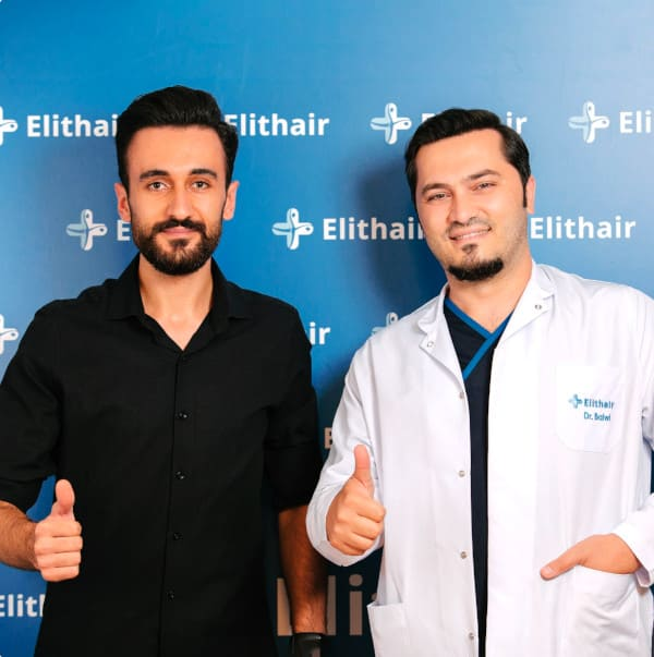 Dr Balwi with a beard transplant patient