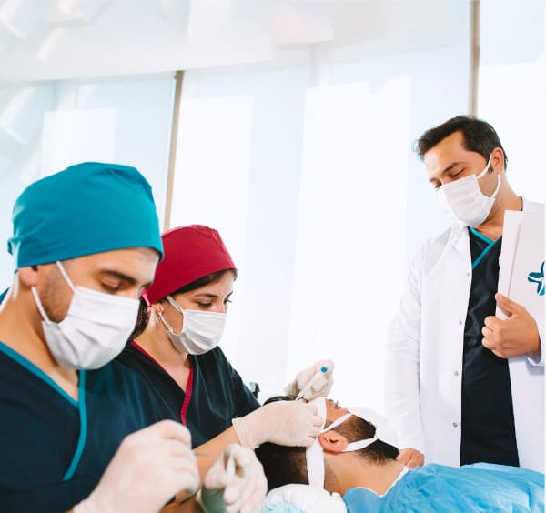 Dr Balwi and his team during a DHI hair transplantation