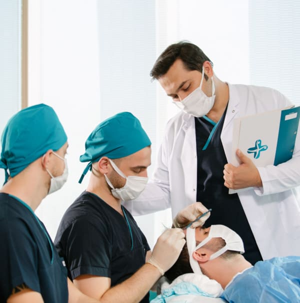Dr Balwi and team performing a hair transplant