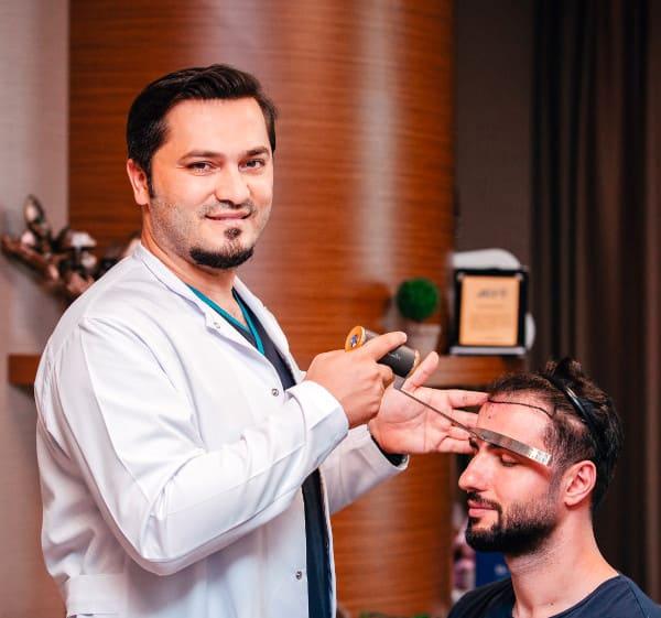 Dr Balwi examining an Elithair patient