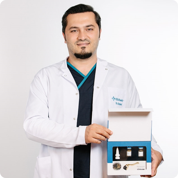 dr balwi holding a neo fue set