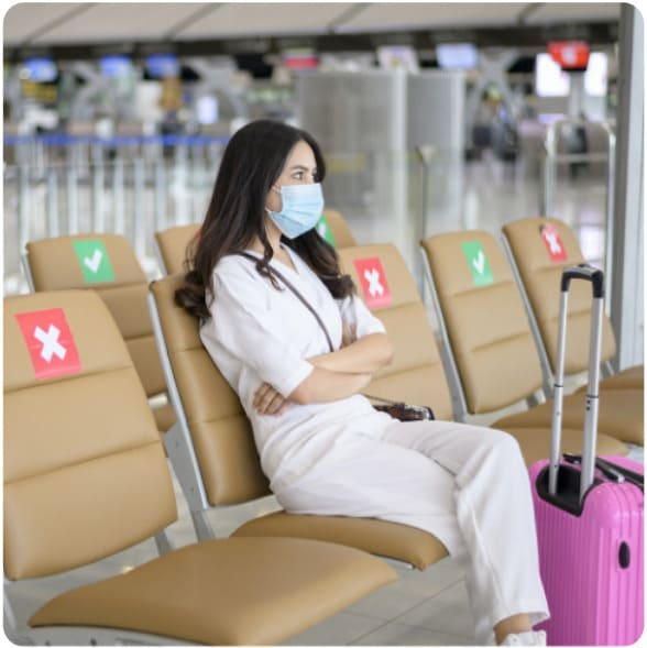 A girl waiting at the airport for her flight during corona