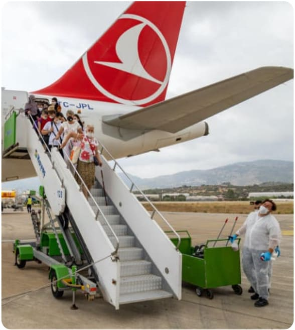 passengers leaving the aeroplane with turkish airlines