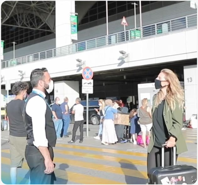 selina is greeted at the airport
